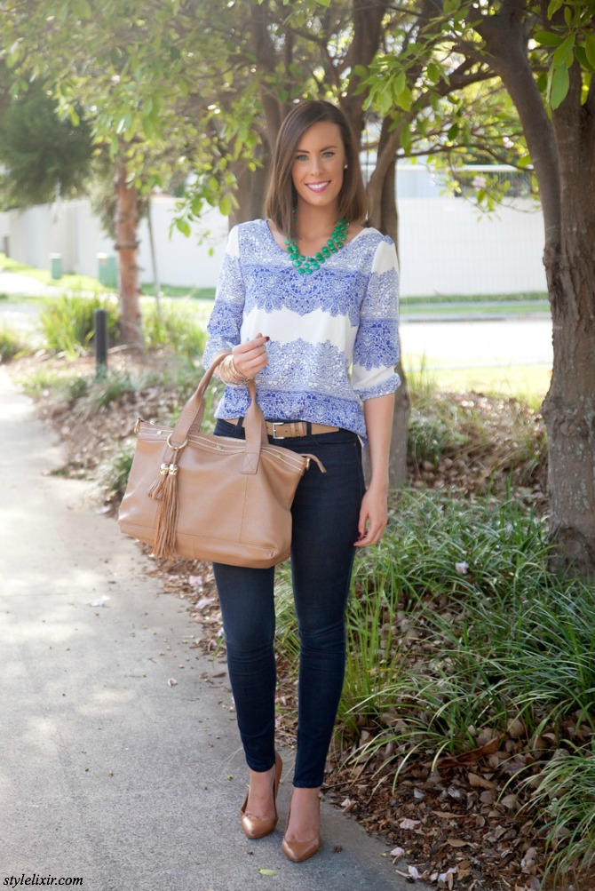 1 Fashion Blue White Lace Print Top Blouse Dark Skinny Jeans Tan Cuore and Pelle Handbag Heels Belt Green Necklace Statement Victorias Secret Makeup Style Elixir www.stylelixir.com