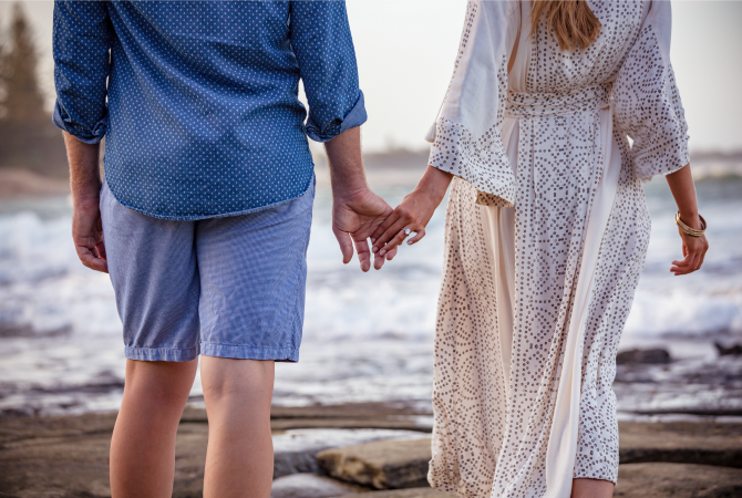 engagement photoshoot on the beach free people dress bohemian wedding oval engagement ring with halo d color diamond couple photos engagement photo outfits for men and ivory white boho dresses
