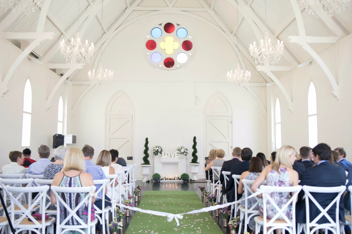high church brisbane pretty white wedding church simply rose petals wedding rose petal toss beautiful wedding flower aisle