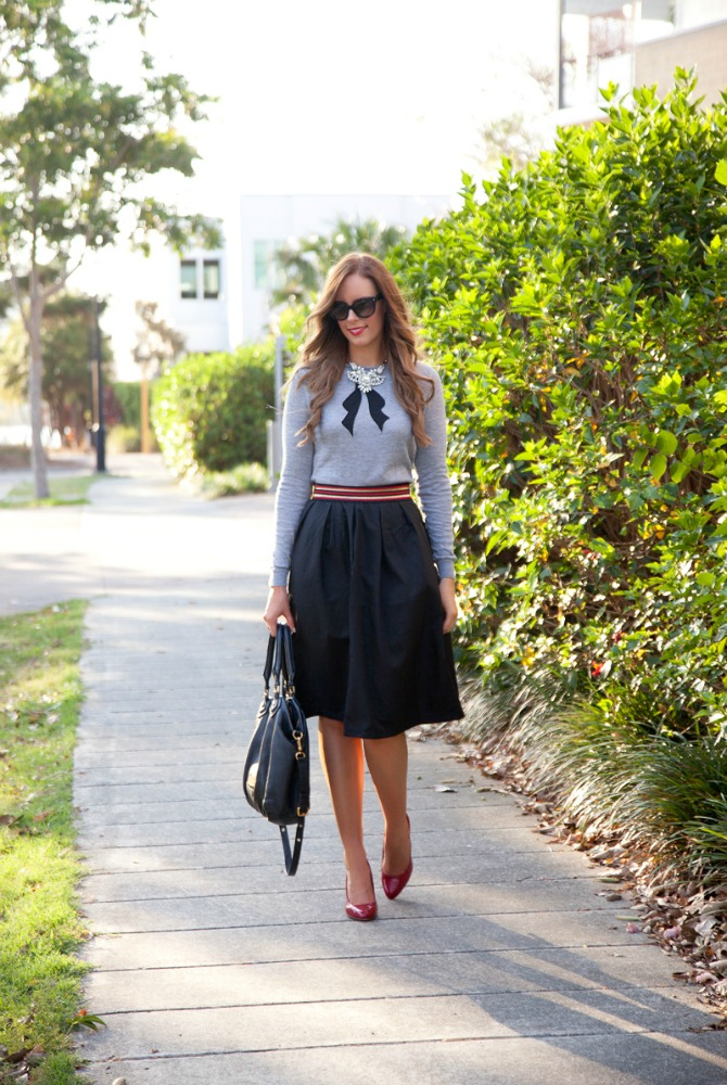 Black A line party skirt grey sweater with bow alice and olivia style fashion blogger style elixir www.stylelixir.com lauren slade prada sunglasses red patent heels marc by marc jacobs fran classic q bag