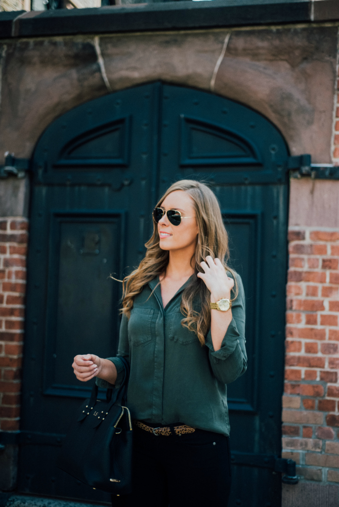 military style olive shirt with black jeans and black patent point derek lam shoes gigi new york monogram handbag fashion in soho new york