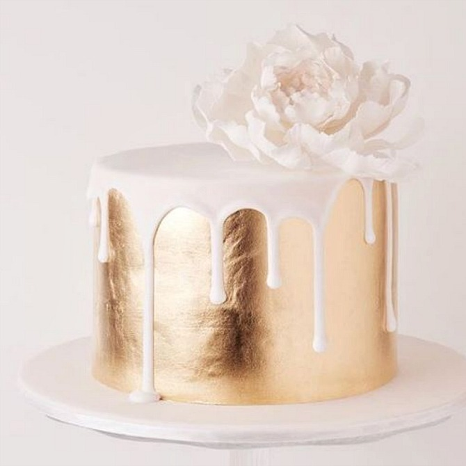 gold and white drip wedding cake