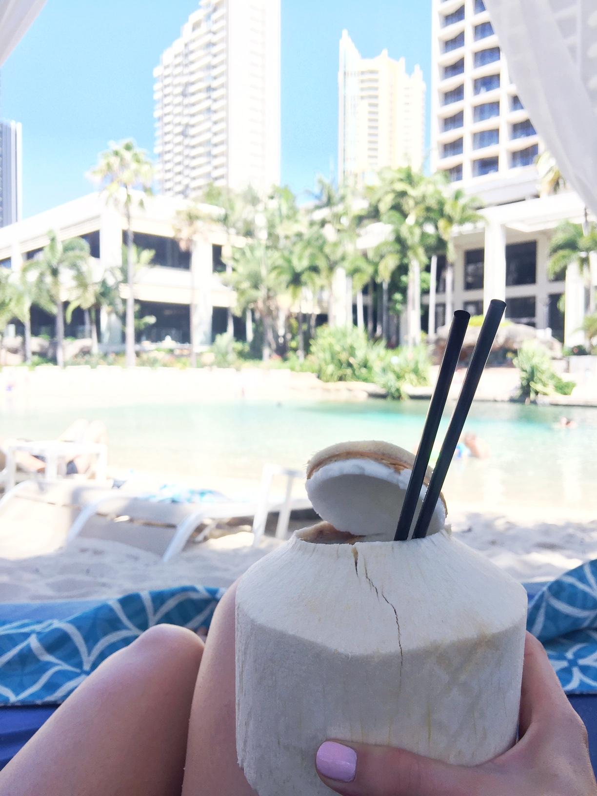 surfers paradise marriott resort and spa gold coast australia beach honeymoon romantic couples holiday luxury vacation hotel review pina colada in coconut pool cabana
