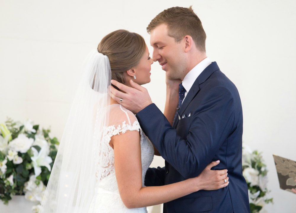 husband and wife first kiss wedding day photo