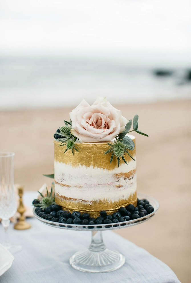 gold brushed wedding cake with blush pink roses rustic bohemian wedding cake | Semi Naked Drip Wedding Cakes featured by popular US lifestyle blogger, Style Elixir