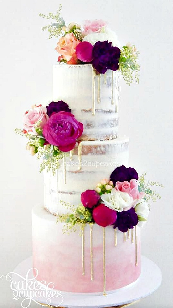 semi naked drip wedding cakes pink ombre and gold with flowers and macaroons three tier cake | Semi Naked Drip Wedding Cakes featured by popular US lifestyle blogger, Style Elixir