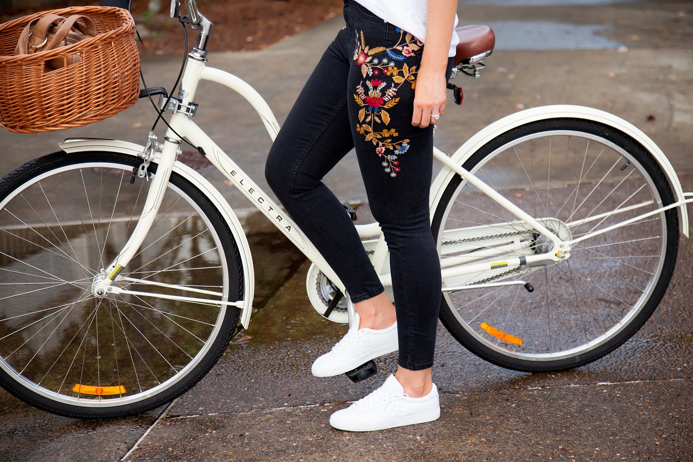 casual outfit ideas embroidered jeans and white tee marigold trend fashion blogger cute cream bike with basket electra cruiser bike lauren slade style elixir blog 6