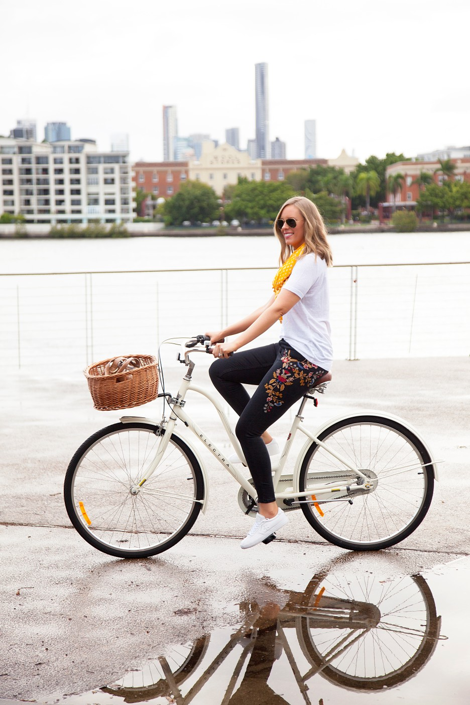 casual outfit ideas embroidered jeans and white tee marigold trend fashion blogger cute cream bike with basket electra cruiser bike lauren slade style elixir blog 7