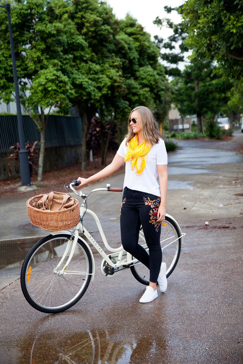 casual outfit ideas embroidered jeans and white tee marigold trend fashion blogger cute cream bike with basket electra cruiser bike lauren slade style elixir blog 9