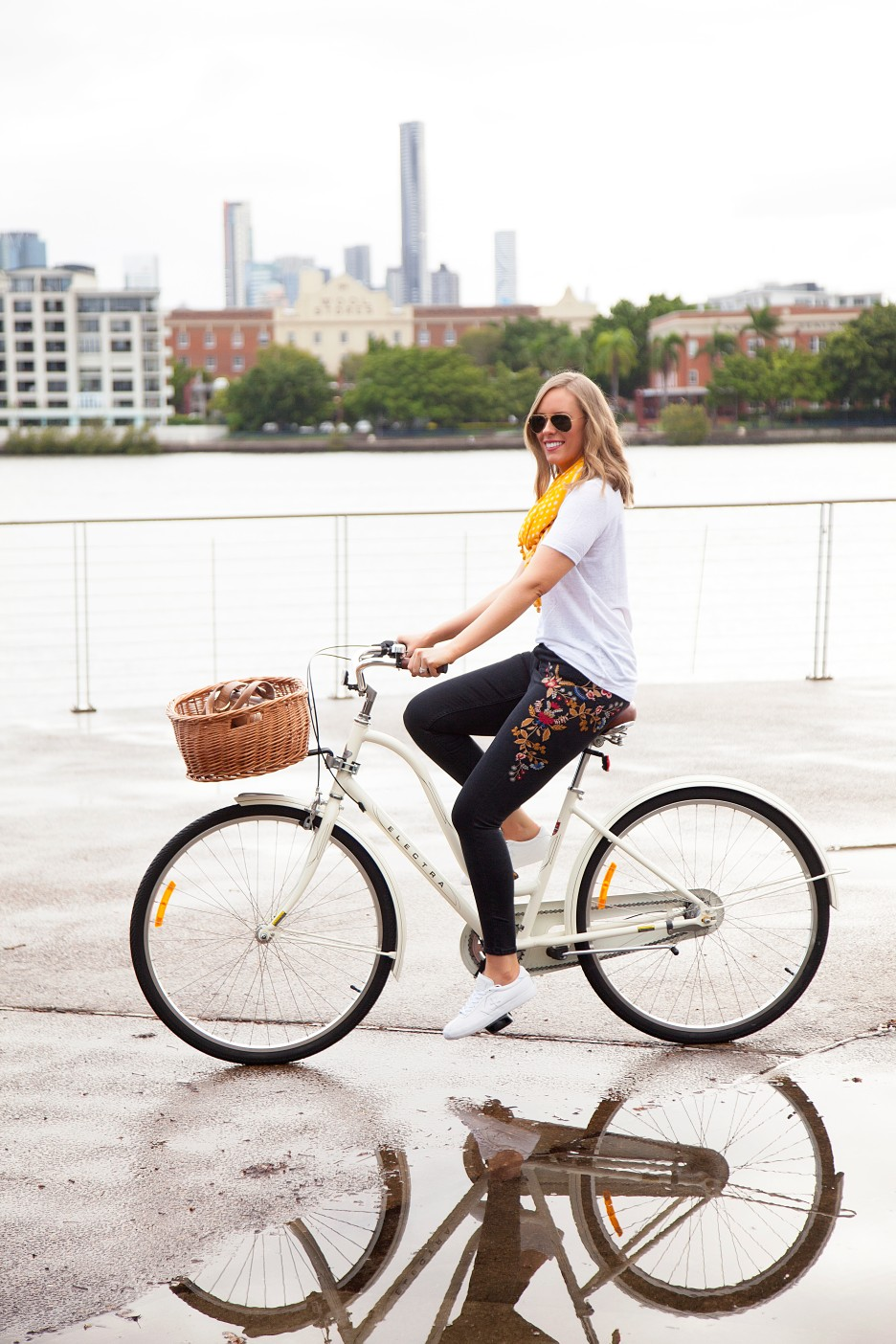 casual outfit ideas embroidered jeans and white tee marigold trend fashion blogger cute cream bike with basket electra cruiser bike lauren slade style elixir blog 2