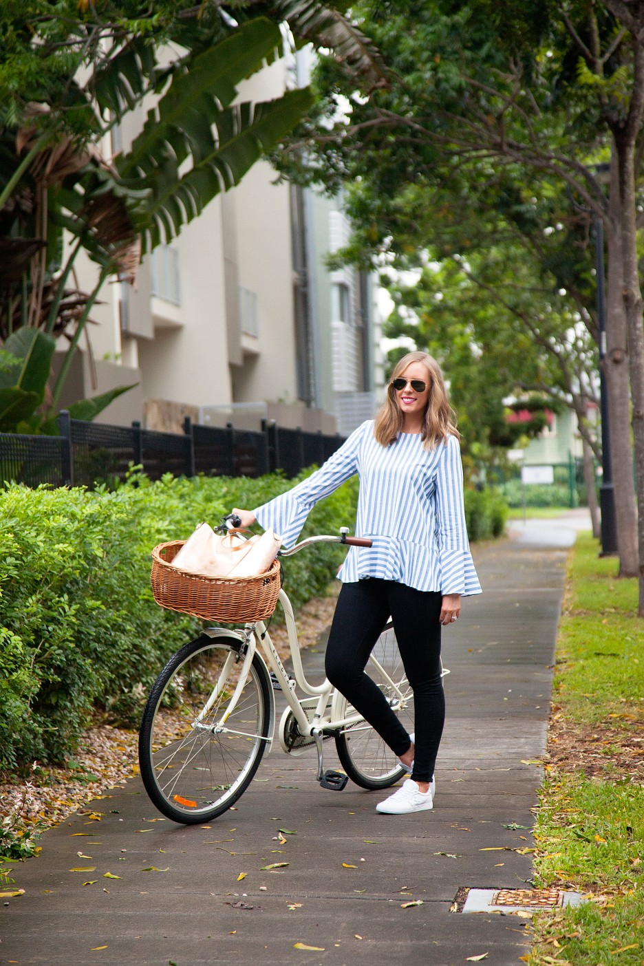 1 Stripe Top Black Jeans and White Converse Sneakers fashion blogger electra bike with basket rose gold tote handbag | One Striped Outfit, Two Ways featured by popular US fashion blogger, Style Elixir