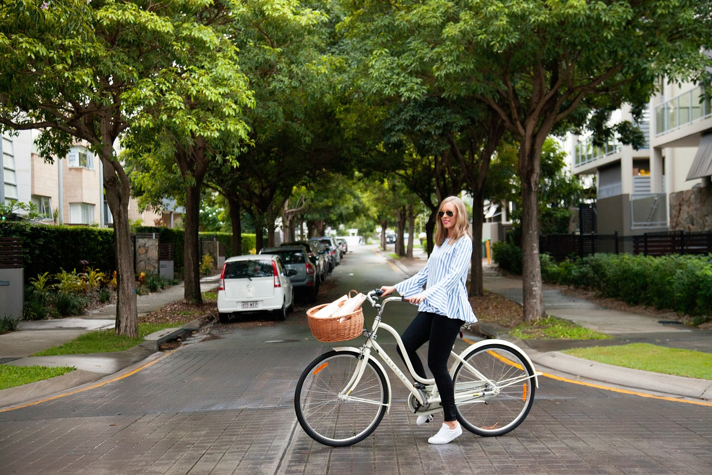 2 Stripe Top Black Jeans and White Converse Sneakers fashion blogger electra bike with basket rose gold tote handbag
