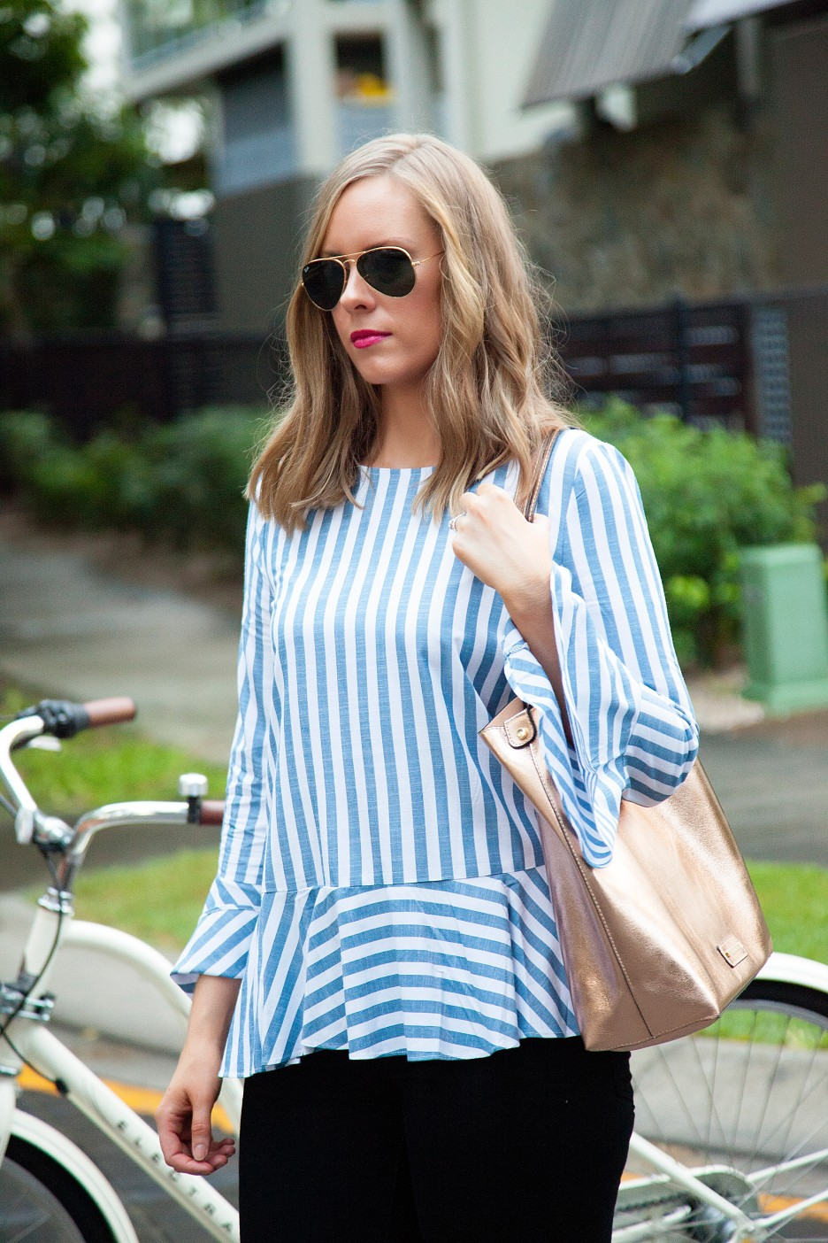 3 Stripe Top Black Jeans and White Converse Sneakers fashion blogger electra bike with basket rose gold tote handbag | One Striped Outfit, Two Ways featured by popular US fashion blogger, Style Elixir