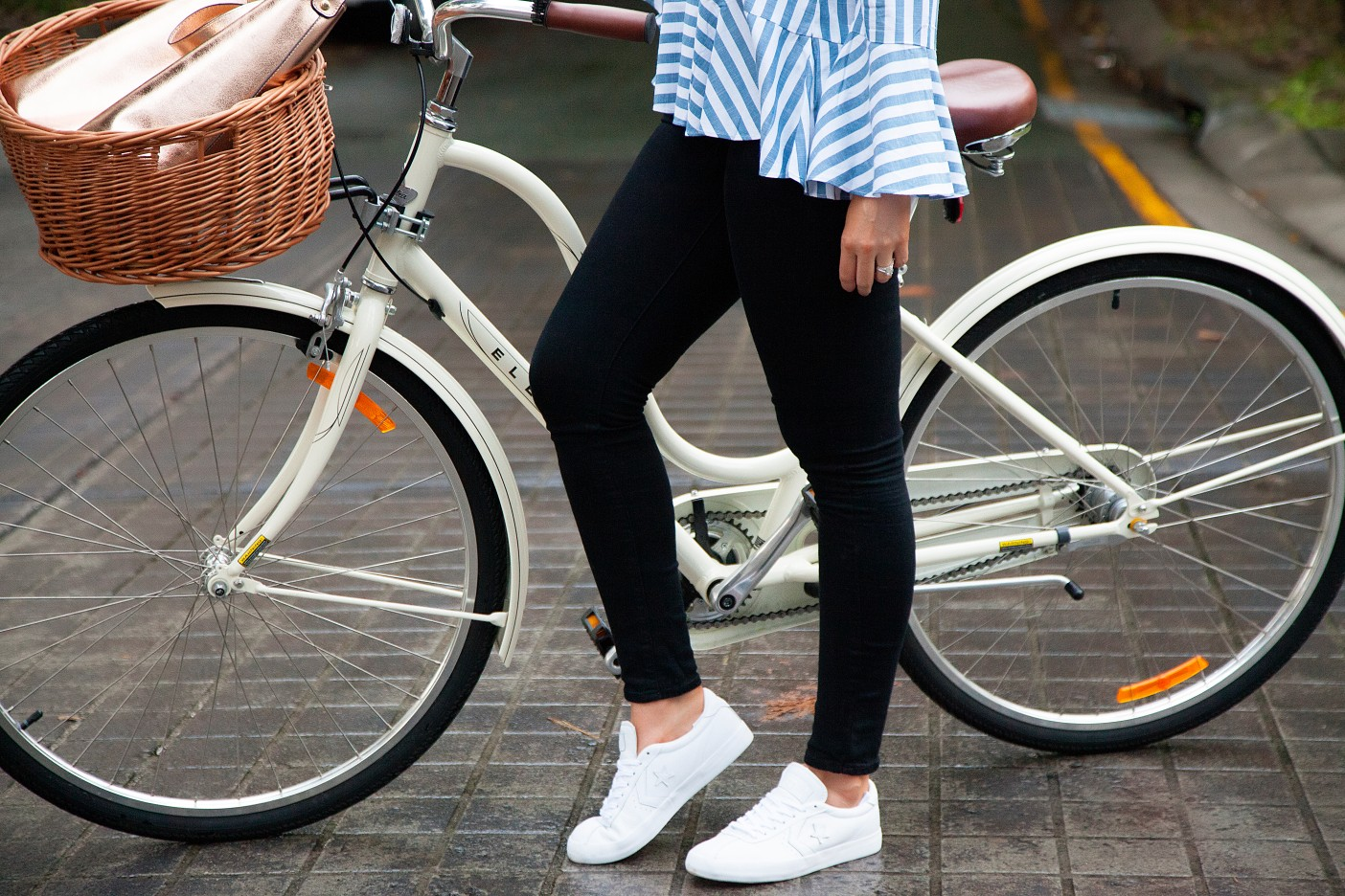 4 Stripe Top Black Jeans and White Converse Sneakers fashion blogger electra bike with basket rose gold tote handbag | One Striped Outfit, Two Ways featured by popular US fashion blogger, Style Elixir