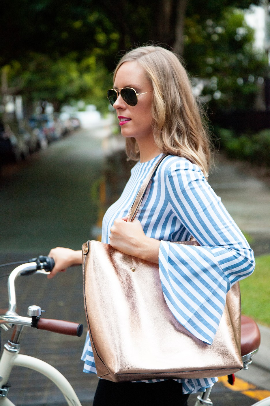 5 Stripe Top Black Jeans and White Converse Sneakers fashion blogger electra bike with basket rose gold tote handbag | One Striped Outfit, Two Ways featured by popular US fashion blogger, Style Elixir