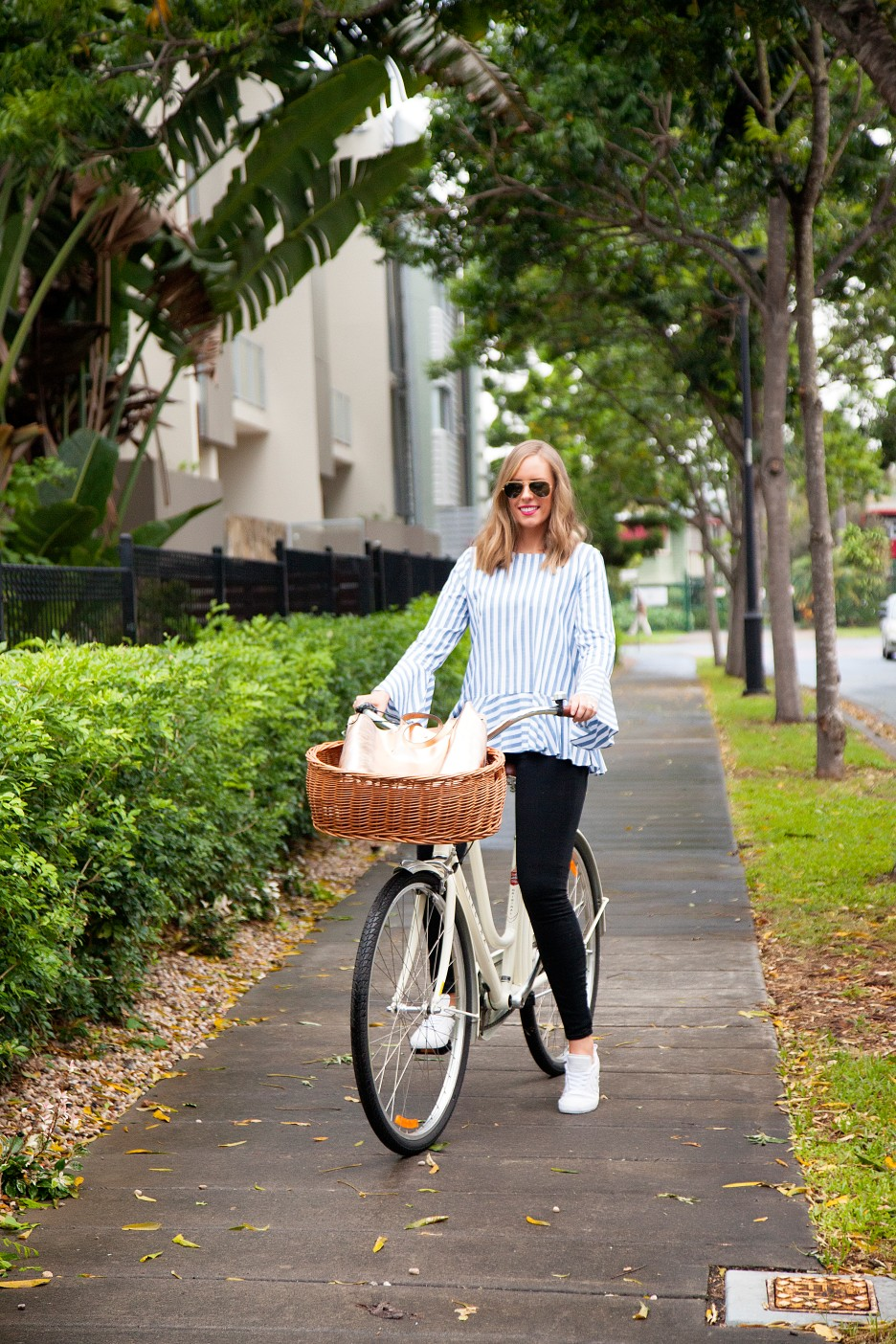 6 Stripe Top Black Jeans and White Converse Sneakers fashion blogger electra bike with basket rose gold tote handbag