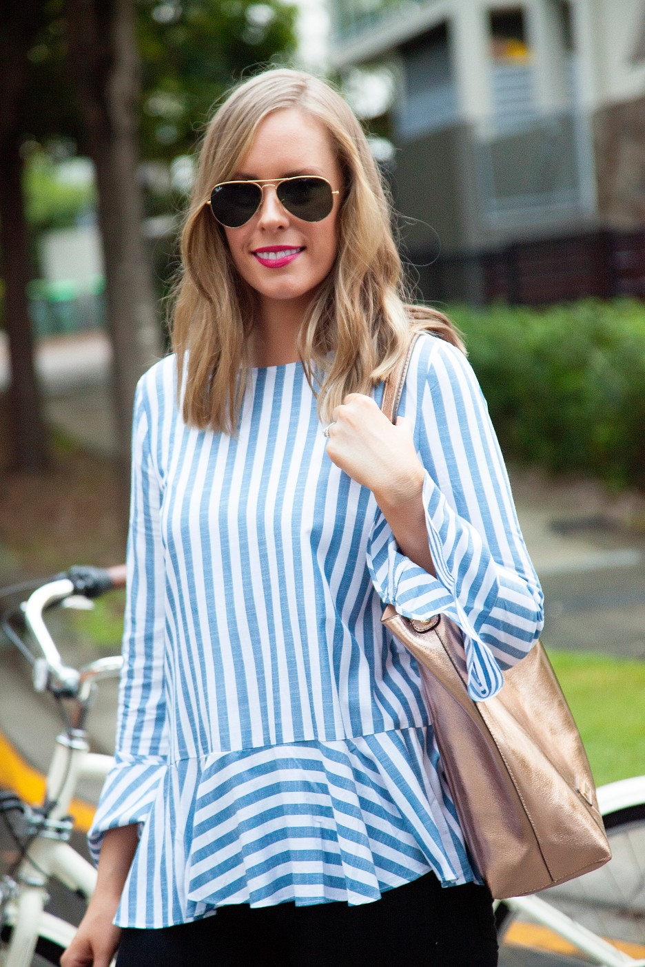 9 Stripe Top Black Jeans and White Converse Sneakers fashion blogger electra bike with basket rose gold tote handbag