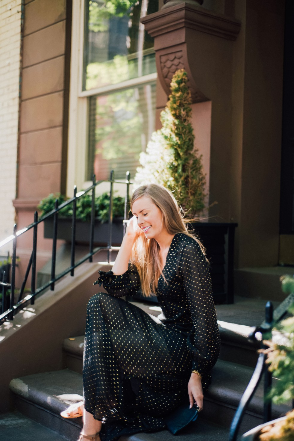 black gold metallic dot maxi dress H&M new york fashion blogger west village lauren slade style elixir blog sitting on new york stoop 2 | 3 Polished Outfit Ideas featured by popular US style blogger, Style Elixir