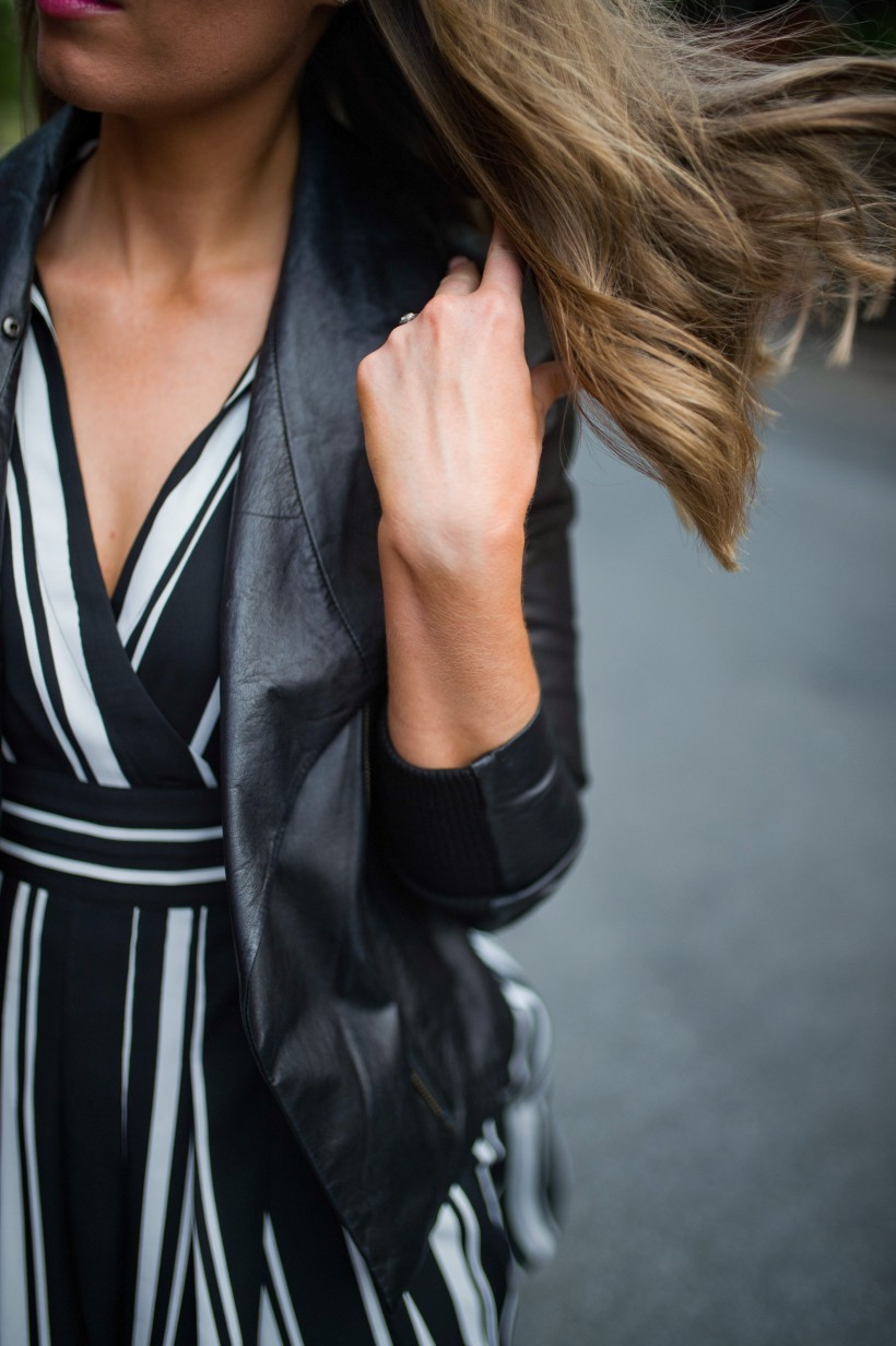 How to Wear a Black and White Striped Dress Outfit for Fall fashion blogger leather jacket white sneakers black and white outfit ideas fashion blogger street style new york 18| INC black and white striped dress styled by top US fashion blog, Style Elixir