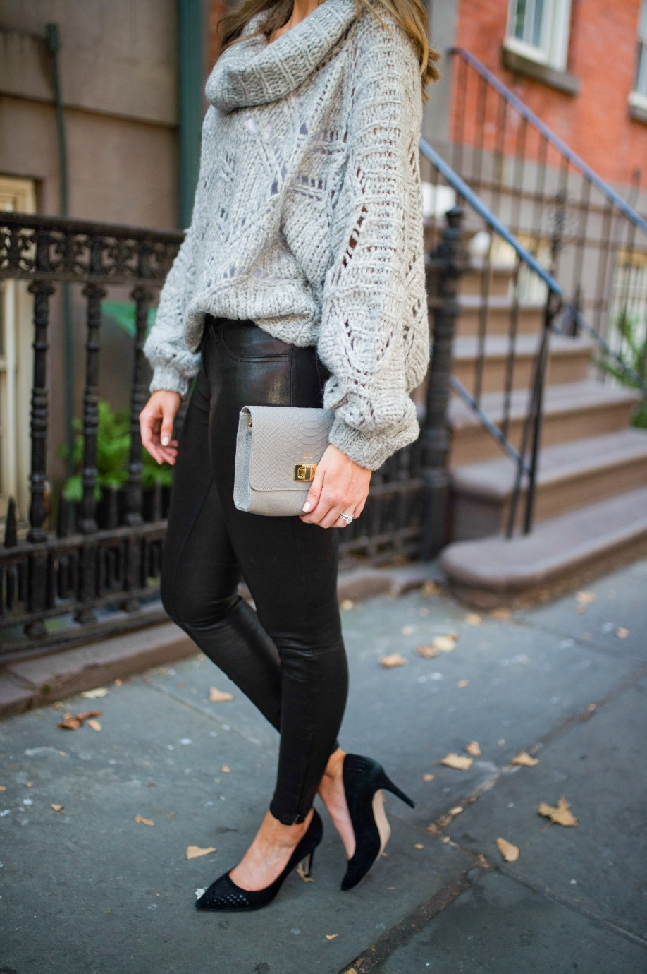 easy outfit ideas fall spring fashion outfit inspo blogger chunky grey knit sweater leather pants 2