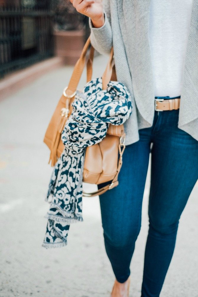 best travel outfit idea grey sweater cashmere paige jeans comfy warm plane outfit for traveling 4