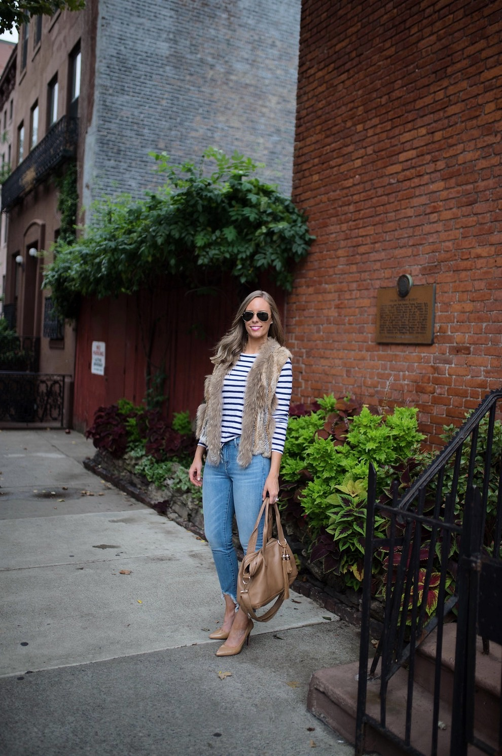 spring weekend outfit idea fur vest navy stripe jcrew top blue ripped jeans 7 for all mankind nude heels blog new york style elixir fashion blogger lauren slade 2